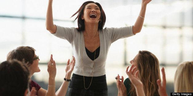 Excited Woman, Arms Raised In Air, During Meeting