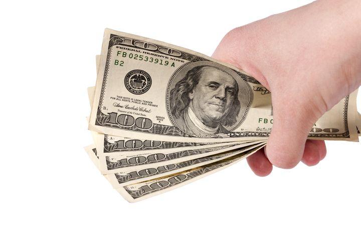 hand holding american dollars...