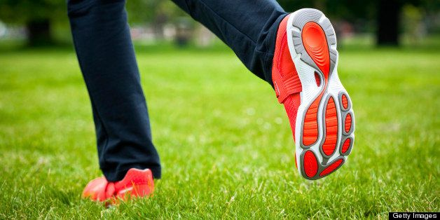 Woman jogging in the park, close up of feet.