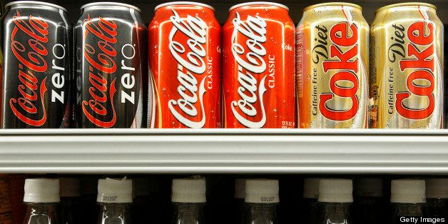 UNITED STATES - FEBRUARY 14:  Cans and bottles of Coca-Cola are displayed in a grocery store in New York, Wednesday, Feb. 14, 2007. Coca-Cola Co., the world's largest soft-drink maker, may say profit rose on the second-biggest sales gain in three years as Europeans bought more no-calorie Coca-Cola Zero soda and the company sold more coffee in Japan.  (Photo by Adam Rountree/Bloomberg via Getty Images)