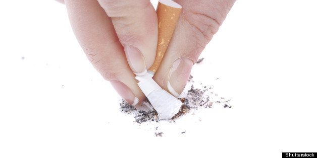 woman hand stub out a cigarette
