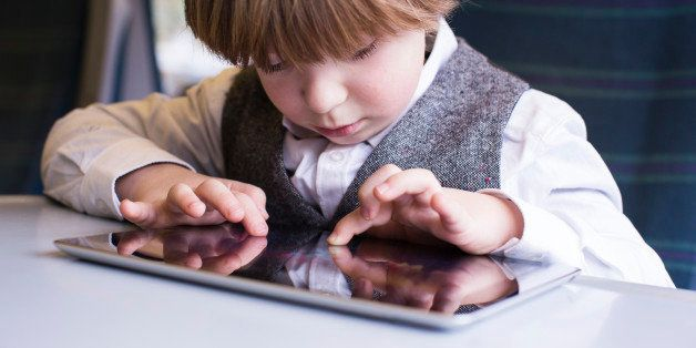 Boy enjoying technology on the the train