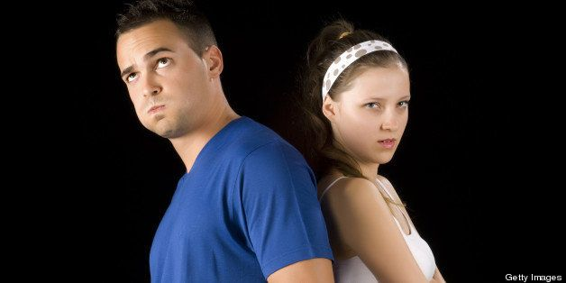 Young couple is back to back because of their problems