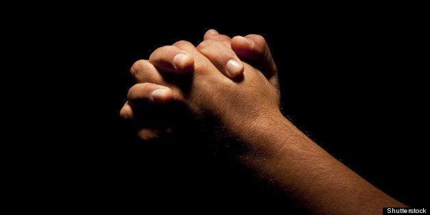 praying hands in black...