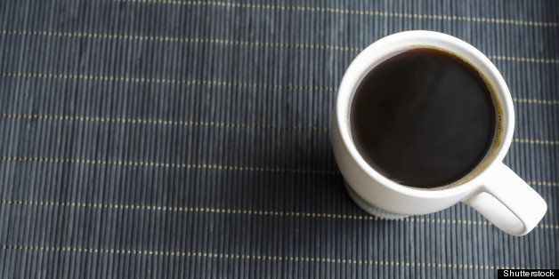 cup of coffee on bamboo napkin