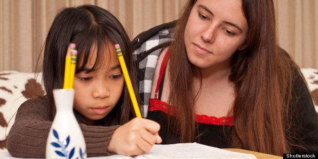 Tutor and Her Student Doing Homework