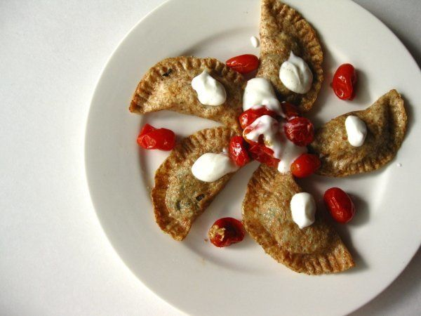 """<strong>Get the <a href=""""http://acquiredflavor.blogspot.com/2010/08/spinach-and-eggplant-pierogi-topped.html"""" target=""""_blank"""""""