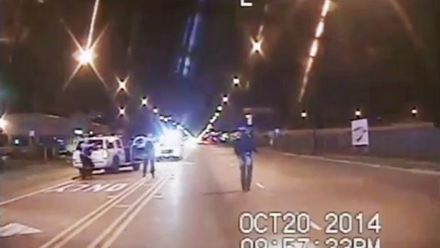 FILE - In this Oct 20 2014 image made from dashcam video provided by the Chicago Police Department Laquan McDonald 17 right walks down the street moments before being fatally shot by Chicago Police Officer Jason Van Dyke in Chicago