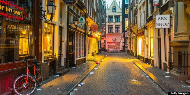A litter filled Red Light District in the early hours of the morning, De Wallen, Amsterdam, Netherlands, Europe.