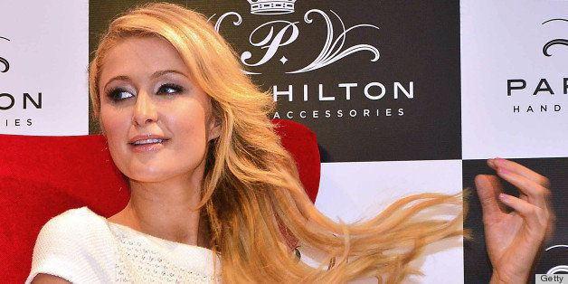 US socialite Paris Hilton attends a press conference at the Hilton Hotel in Bogota, on April 24, 2103. Hilton is in Colombia to launch her collection of bags. AFP PHOTO/Luis Acosta        (Photo credit should read LUIS ACOSTA/AFP/Getty Images)