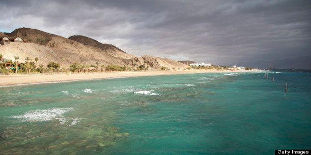 View of Eilat coastline with coral reef visible and dramatic sky