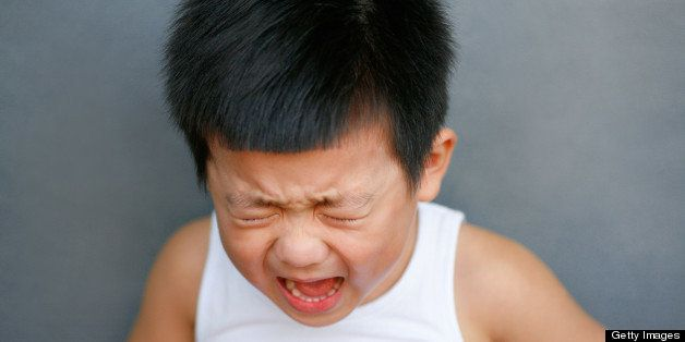 Small boy crying.