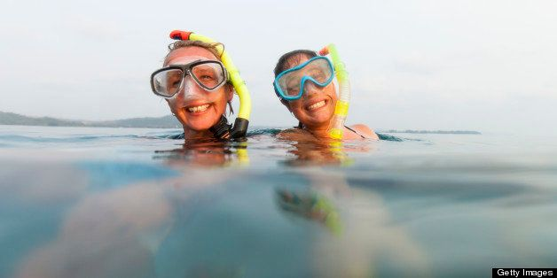 Portrait of two female snorkelers