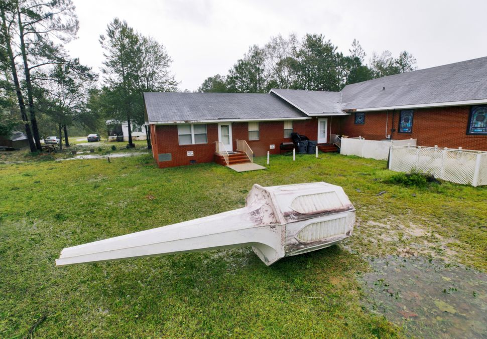 Bethlehem Missionary Baptist Church's steeple lies on the ground next to the church in Winnabow, North Carolina.