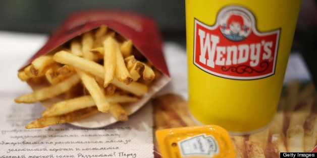 A customer's meal of French fries and a soft drink sit on a tray inside a Wendy's fast food restaurant in Moscow, Russia, on Friday, April 5, 2013. McDonald's, which virtually created the market for burgers and fries in the country and convinced Russians it's OK to eat with their hands, must fend off a growing challenge from rivals Burger King Worldwide Inc., Subway Restaurants, Yum! Brands Inc. and Wendy's Co. Photographer: Andrey Rudakov/Bloomberg via Getty Images