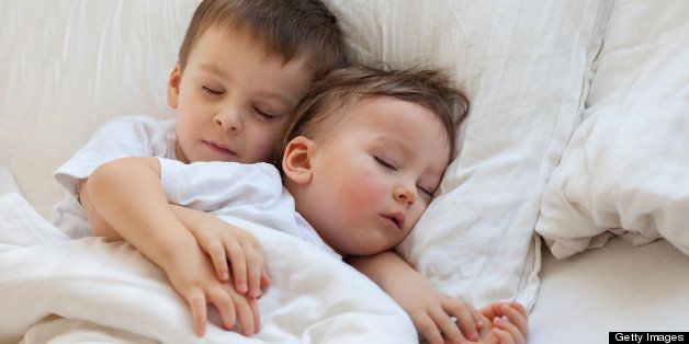 Two boys sleeping, brothers