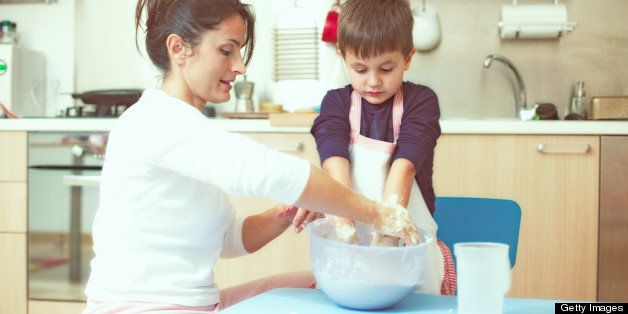 Mother and son cooking in their kitchen
