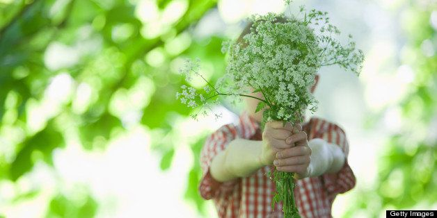 Boy offering bouquet of flowers