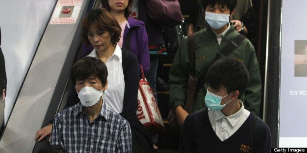TAIWAN, CHINA - APRIL 26: (CHINA MAINLAND OUT)  Citizens wore masks to protect themselves from H7N9 on Friday April 26, 2013 in Taipei, Taiwan, China. Taiwan Central Epidemics Command Center confirmed first H7N9 case in Taiwan on April 24.  (Photo by TPG/Getty Images)
