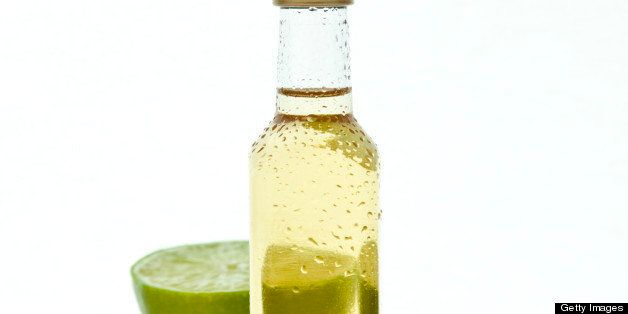 Small tequila or rum bottle with lime
