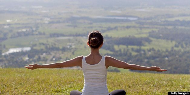 woman practicing yoga outdoor