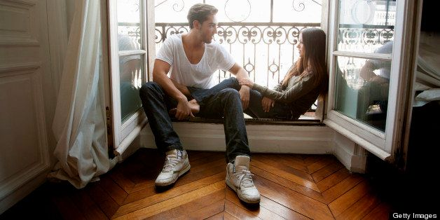 Couple sitting in windowsill