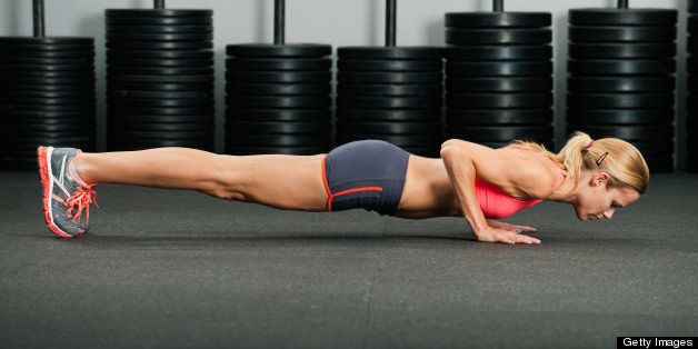 Caucasian woman doing push-ups