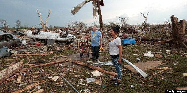 MOORE, OK- MAY 20:  Philip Gotcher and his daughter Monica stand in the rubble of his house after a powerful tornado ripped t