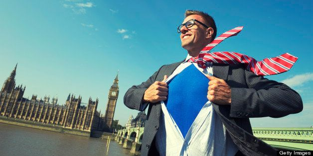 Smiling superhero stands ready for action on a bright day in front of the London skyline at Westminster Palace