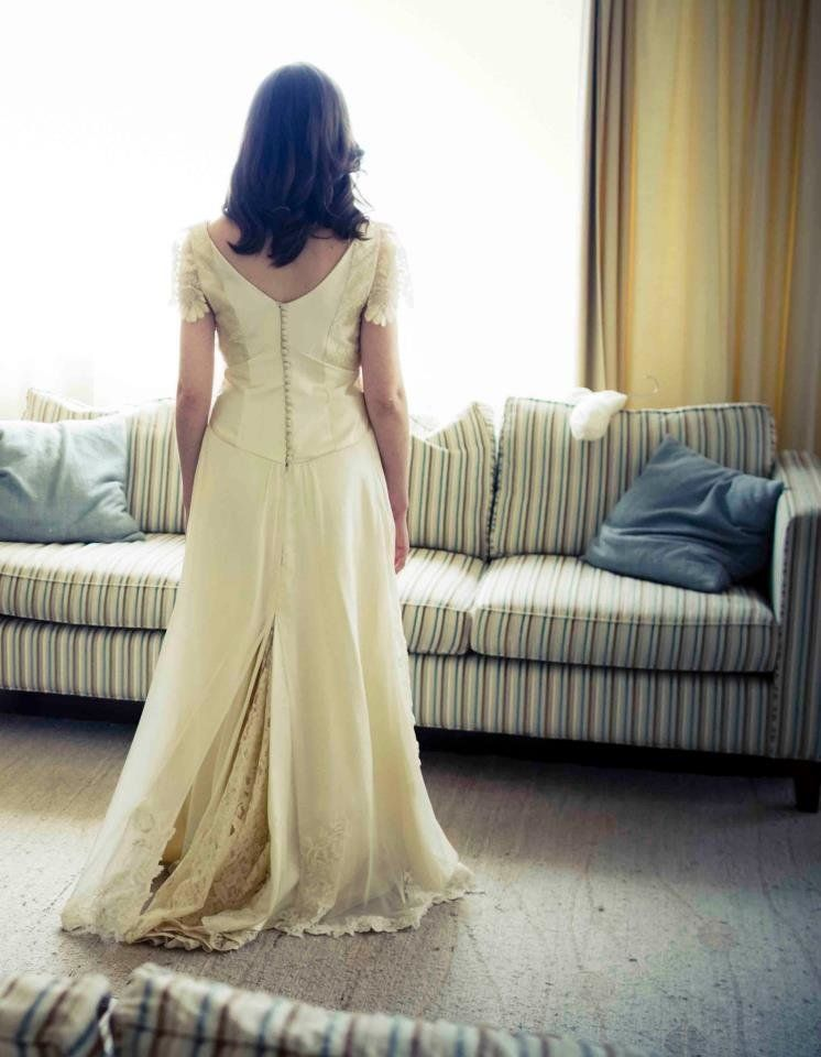 """""""My dress was extremely meaningful to me. It was handmade by a friend, and combined my grandmother's wedding dress, my mom's"""