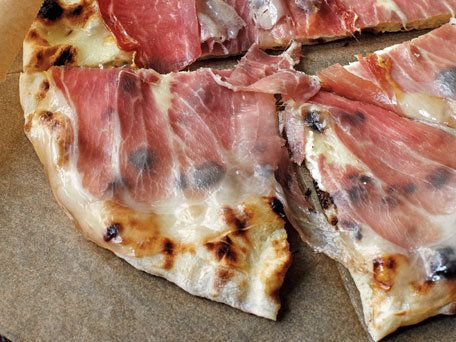 "<strong>Get the <a href=""http://www.huffingtonpost.com/2012/03/20/pizza-dough_n_1367825.html"">Pizza Dough</a> recipe</strong>"
