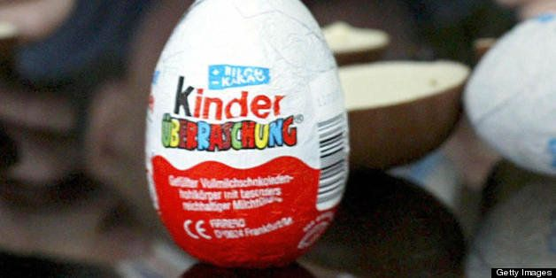 FILES - A picture dated November 25, 2002 in Frankfurt/Main shows a boy with a 'Kinder Surprise' chocolate egg. Despite being a massive hit with children and adults alike, German lawmakers want to ban Kinder surprise eggs on safety grounds, press reports said on August 7, 2008.     AFP PHOTO    DDP/MARTIN OESER    GERMANY OUT (Photo credit should read MARTIN OESER/AFP/Getty Images)