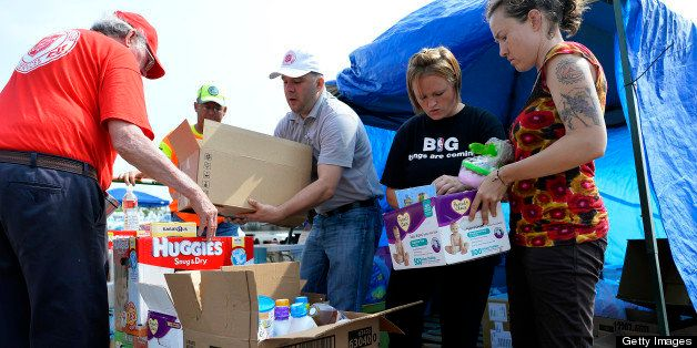 Volunteers arrange relief goods for tornado victims at a parking lot in Moore, Oklahoma, on May 24, 2013. The tornado, one of