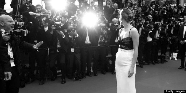 BLACK AND WHITE VERSION British actress Emma Watson poses on May 16, 2013 as she arrives for the screening of the film 'The Bling Ring' presented in the Un Certain Regard section at the 66th edition of the Cannes Film Festival in Cannes. Cannes, one of the world's top film festivals, opened on May 15 and will climax on May 26 with awards selected by a jury headed this year by Hollywood legend Steven Spielberg. AFP PHOTO / VALERY HACHE        (Photo credit should read VALERY HACHE/AFP/Getty Images)