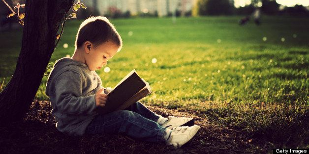 Little boy reading book.