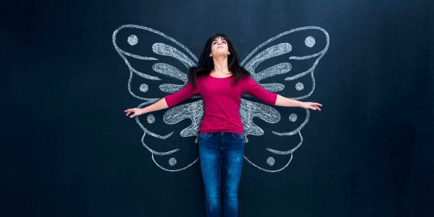 Woman flying with butterfly wings.
