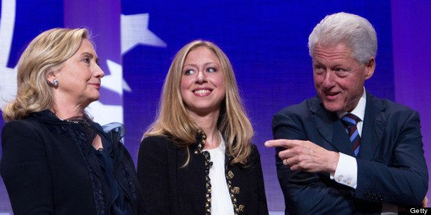 NEW YORK CITY- SEPTEMBER 22: Former US President Bill Clinton (R) stands on stage with his wife Hillary Rodham Clinton (L), Secretary of State, and their daughter Chelsea Clinton during the closing Plenary session of the seventh Annual Meeting of the Clinton Global Initiative (CGI) at the Sheraton New York Hotel on September 22, 2011 in New York City. Established in 2005 by former U.S. President Bill Clinton, the CGI assembles global leaders to develop and implement solutions to some of the world's most urgent problems. (Photo by Daniel Berehulak/Getty Images)