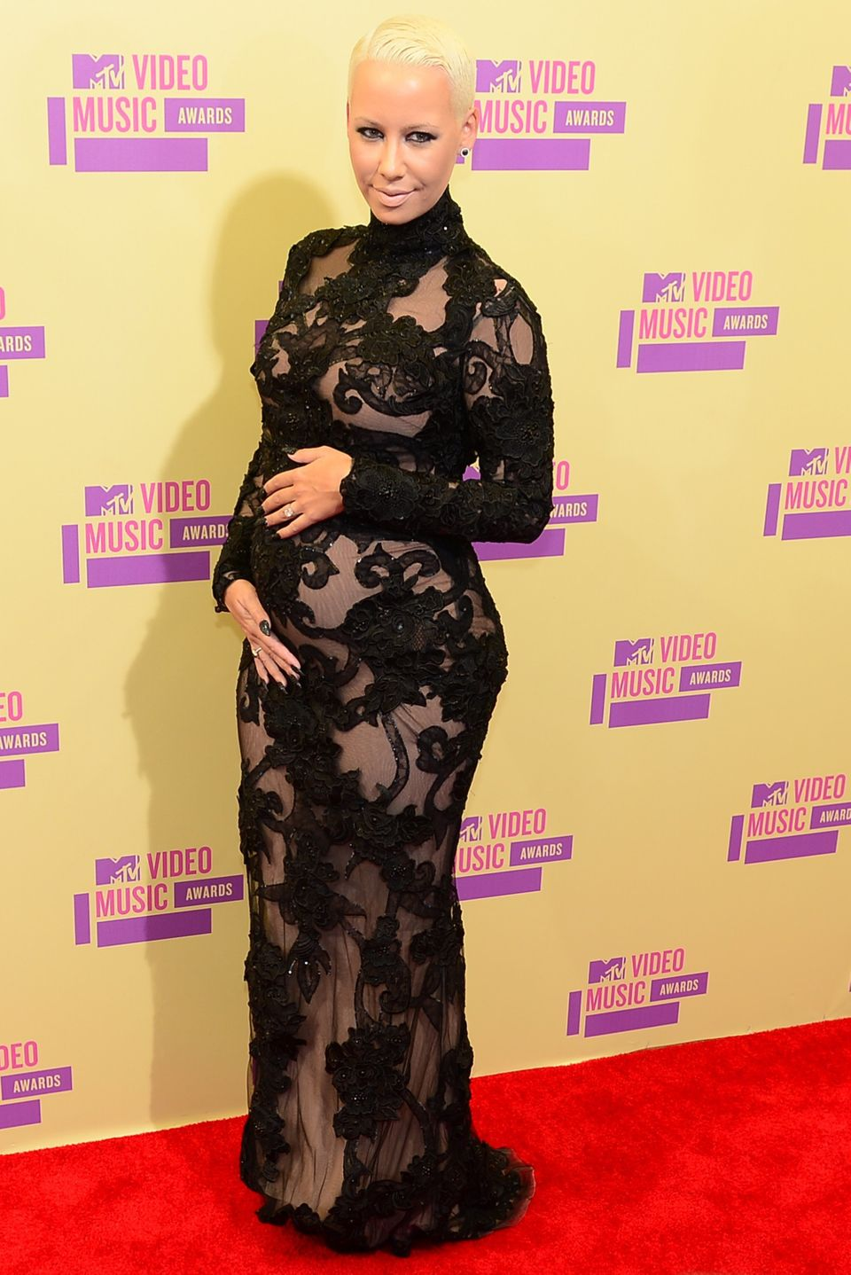Amber Rose poses on arrival on the red carpet for the MTV Video Music Awards in Los Angeles on September 6, 2012 in Californi