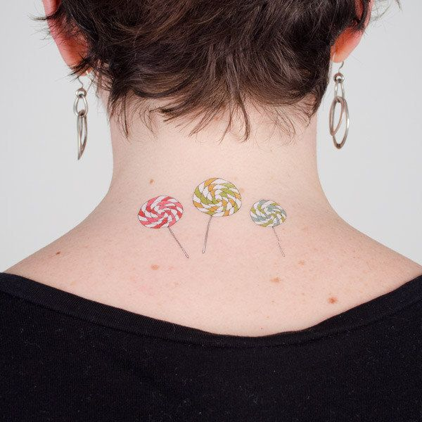 """<strong><a href=""""http://tattly.com/products/lollipops"""" target=""""_blank"""">Lollipops Tattoo Set</a>, $5.00 on Tattly</strong>"""