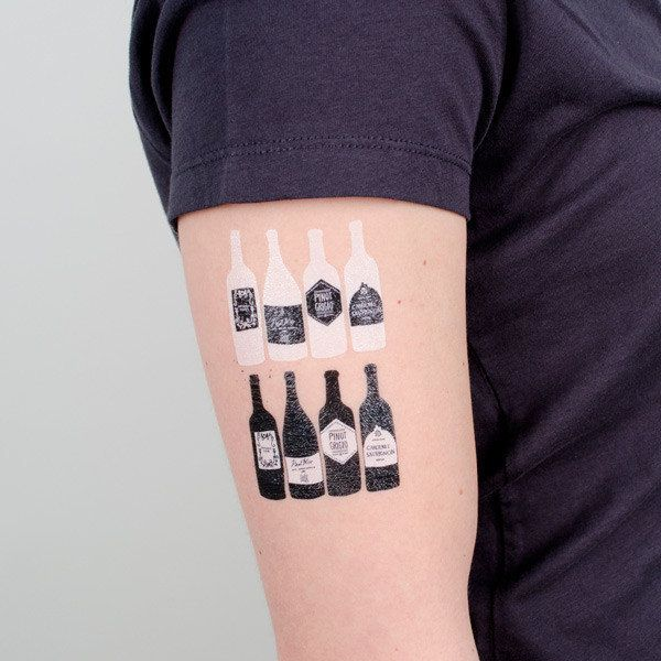 """<strong><a href=""""http://tattly.com/products/bottles"""" target=""""_blank"""">Wine Bottles Tattoo Set</a>, $5.00 on Tattly</strong>"""