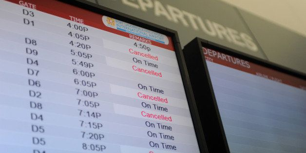 A departures screen displays cancelled flights at Fort Lauderdale-Hollywood International Airport in Fort Lauderdale, Florida
