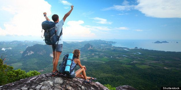young happy backpackers on top...
