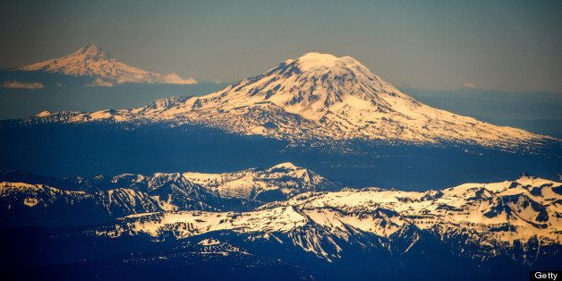Mount St. Helens, backgrounded  by Mount Rainier (L), is seen southeast of Seattle in the state of Washington, United States on June 10,2013.      AFP PHOTO/JOE KLAMAR        (Photo credit should read JOE KLAMAR/AFP/Getty Images)