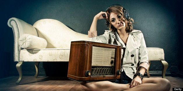 Portrait of retro young woman listening music