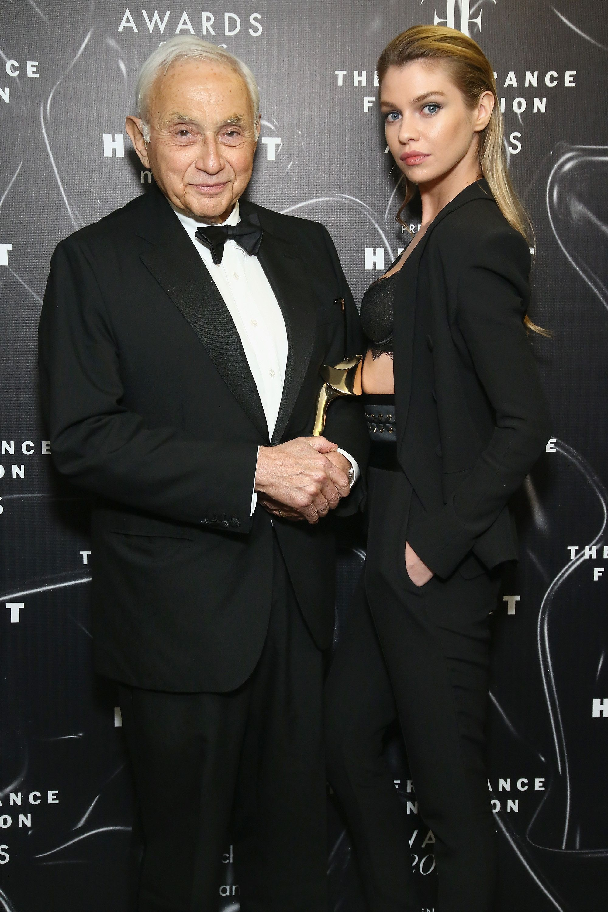NEW YORK, NY - JUNE 07:  Les Wexner (L) and Stella Maxwell pose at the 2016 Fragrance Foundation Awards presented by Hearst Magazines - Show on June 7, 2016 in New York City.  (Photo by Astrid Stawiarz/Getty Images for Fragrance Foundation)