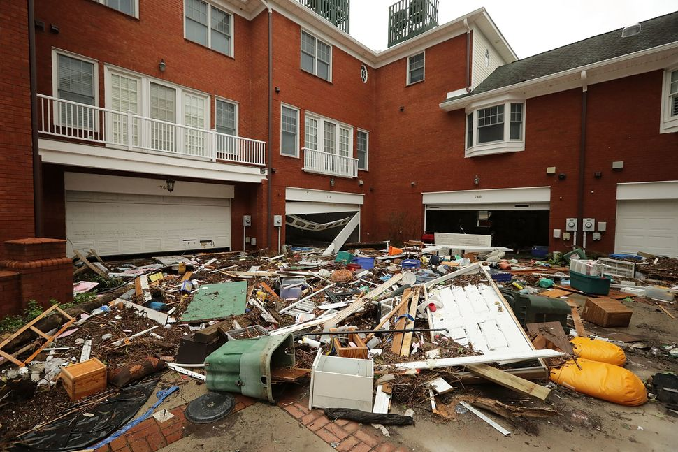 The courtyard at Queen's Point condos is filled with residents' belongings after the storm in New Bern.