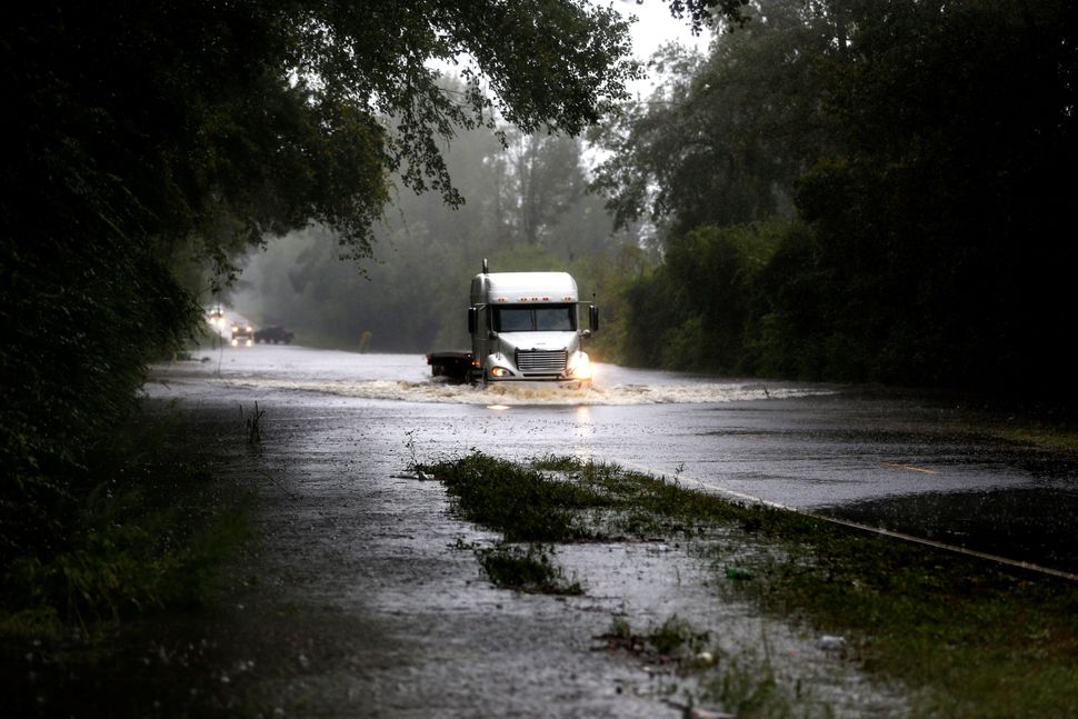 A truck goes through a flooded street during the Duplin County, North Carolina.
