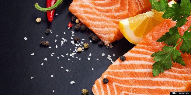fresh salmon on black plate
