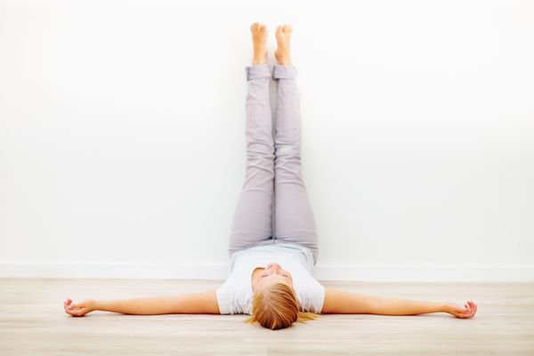 This simple pose, performed against a wall, is excellent for evening relaxation and stress relief. Bielkus recommends staying