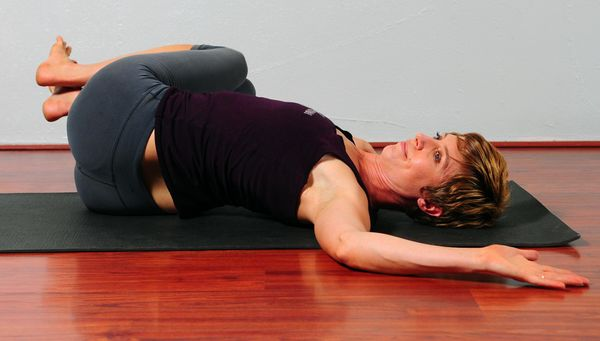 This reclining twisted pose can easily be performed in bed before you fall asleep. Lie down on your back and bring the right